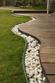 Wood Deck at Ground Level With Rock Edging.