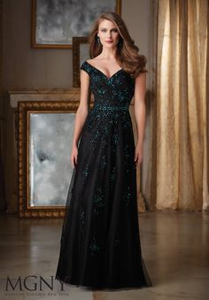 Evening Gowns and Mother of the Bride Dresses by MGNY Contrasting Beaded  Appliques on Net Colors available  Black Teal 2cdeb16ef1c0
