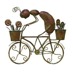Ancient Graffiti Busy Metal Ant Riding Bicycle by Ancient Graffiti. $21.00. Created using natural materials. Nature-inspired gifts. Measures 11-inch l by 10-inch w by 2-1/2-inch h. Creates an artistic blending of your style and garden environment. Ancient graffiti busy metal ant riding bicycle. This nature-inspired gift and accessory for your garden is created using natural materials. Handcrafted to create an item that is handsome, built to last, and of good value. This i...