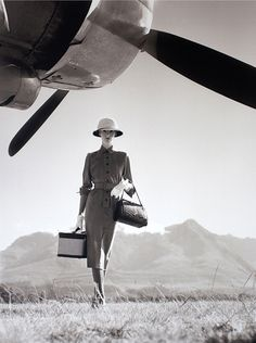 Wenda Parkinson photographed waiting for the Hermes plane to be repaired at Nairobi airport. 1951  NORMAN PARKINSON