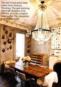 love the juxtaposition of a crystal chandelier above an old French farm table