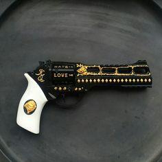Harley's suicide squad gun, my favorite is the love/hate engravings.
