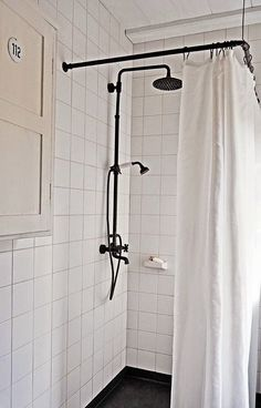 Remodelista Home Inspiration Stories in One Place Christian made the black shower curtain rod from old metal fittingsChristian made the black shower curtain rod from old metal fittings Black Shower, Black Shower Curtains, Shower Fixtures, White Shower, White Bathroom, Shower Curtain Rods, Bathrooms Remodel, Classic Showers, Bathroom Inspiration