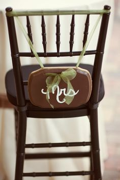 Mrs. Sign.. I think if you used different colors and put the sign higher on the chair this could work. plaques are cheap at Hobby Lobby and you can re purpose afterwards!