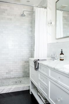 Splendor in the Bath. White cabinets and marble.