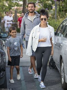 Amicable exes! Kourtney Kardashian showed off a smile as she was spotted heading to dinner with ex Scott Disick and their son Mason in Calabasas, California on Friday