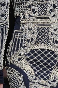 Opulent pearl embellished dress detail with structured pattern; haute couture embroidery // Balmain