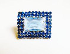 Hey, I found this really awesome Etsy listing at https://www.etsy.com/listing/173084059/vintage-london-blue-rhinestone-art-deco
