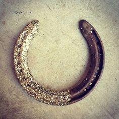 Golden glitter dipped horseshoes