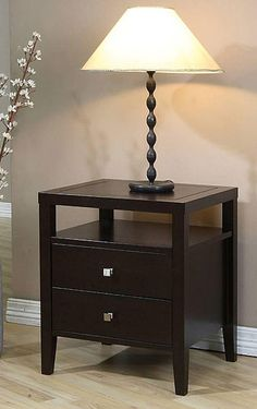 This brown two-drawer nightstand looks elegant in any bedroom. The two drawers and a shelf provide ample storage space for magazines and alarm clocks. The rubberwood stand is durable and looks charming, so it's sure to suit the room.