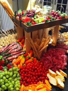 Antipasti cheese board display using a full kitchen island...it's a great way to make an impact