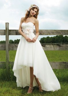 Glamorous High Low Hemmed Wedding Dress with Sweetheart Neckline--- with an added halter neck, change out white flower/sash for black and I think I might really like this one