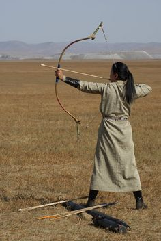 Taken during my 3 month stay in Mongolia. The sole female competitor in an archery competition aims at a distant target. Mongolian Archery, Archery Competition, Woman Archer, Traditional Archery, Poses, Central Asia, Tibet, Photos Du, People Around The World