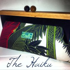 """The haiku clutch is done in our regular size with a beautiful high quality modern tropical canvas fabric , ball handle and neon transparent acrylic tag .  dimensions are 7"""" tall and 14"""" wide at the bottom . handle has magnetic secure closure.we take pride in making our bags with quality please allow 3-5 business days to send out .*see 2nd picture for sizing"""