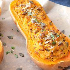 Recette du butternut farcie au parmesan, poireau et trio de quinoa. Une recette d'accompagnement avec données nutritionnelles.