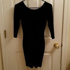 Velvet bodycon dress Velvet, fitted dress. 3/4 length sleeves. Corset like back, runs the entire length. Dresses Mini