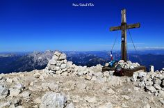 The cross on the summit of the Mangart mountain in the Julian Alps, Slovenia