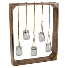 Wall garden with five hanging jars.  Product: Wall gardenConstruction Material: Wood, rope and glass...