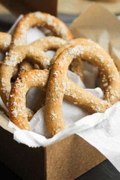 """Easy Pennsylvania Dutch Soft Pretzels  1 (1 pound) loaf frozen white bread dough 1 egg   Thaw the bread and divide into 16 pieces. Roll each piece into a 15"""" rope; twist into the pretzel shape. Place on greased cookie sheet. Beat the egg with 1 tablespoon water and brush on pretzels; sprinkle with coarse salt. Bake at 425 degrees for 15 to 20 minutes. You could substitute the salt with coarse sugar."""