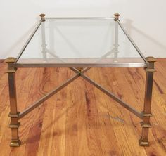 Mid Century Glass, Steel and Brass Coffee Table | From a unique collection of antique and modern coffee and cocktail tables at http://www.1stdibs.com/furniture/tables/coffee-tables-cocktail-tables/