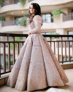 Pastel color engagement gown with hooded sleeves Bride in a pastel color gown with sequins work Indian Wedding Gowns, Indian Gowns Dresses, Indian Fashion Dresses, Engagement Dress For Bride, Engagement Gowns, Bridal Outfits, Bridal Dresses, Simple Gowns, Elegant Gowns