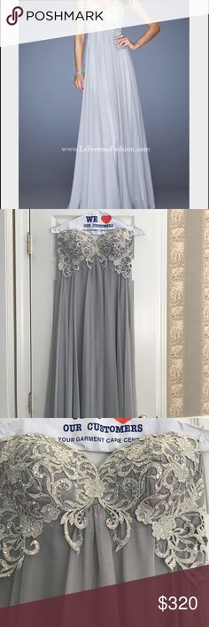 "Beautiful Gray/Silver La Femme Strapless Dress Beautiful Gray/Silver La Femme Strapless Dress. This dress is a size 8 & has been worn only once before and only for a few hours. Perfect for a prom, wedding, and plenty more special occasions. I'm 5'7 & wore it with FLATS! SO this would also work with someone shorter with heels. ALSO can be hemmed!!  ""Empire waist chiffon gown with a sweetheart neckline. Bodice is covered with a colored lace that is embellished with small jewels. Back zipper…"