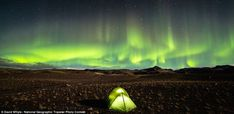 Happy Camping: 'Camping beneath the beauty of the Aurora Borealis in Southern Iceland in the Fall of 2013. An odd sort of reflection with the tent and the sky happening.'