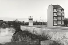 View over the Berlin Wall in 1985, detached house next to a watchtower adjacent to the inner German border, known as the Death Strip.