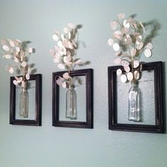 cute! Dollar store frames, Dollar aisle (IKEA) vases, wrapped with floral wire around the vases and secured with a dot of glue. Added floral stems in the top and hung in my bathroom. What a steal for some awesome decor! $12