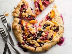 Ina fills her crust with peaches, plums, blueberries and and a touch of orange juice for a delicious treat.