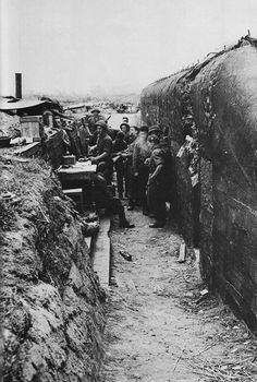 Allied troops outside a German bunker after D-Day landings. June 1944.