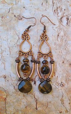 Beautiful handcrafted ornate Earrings made with genuine Tigers Eye gemstones in 8mm, 6mm faceted, faceted teardrop, on Copper chandelier findings with Copper tube beads, with Copper (plated) fish hooks. Drop measure from base of fish hook is 2+1/3 inch long.
