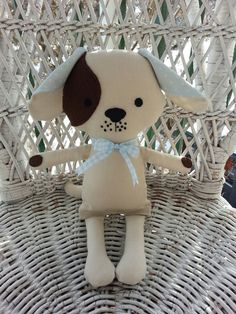 A handmade cloth puppy dog doll.  www.facebook.com/dandelionwishesbymimi  www.dandelionwishesmimi.etsy.com