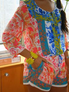 Love it! Love it! The pattern is so fun and bright on this romper and I am diggin that yellow bracelet! La Belle Vie