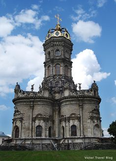The baroque church in Dubrovitsy near Moscow, Russia. It's true, the constriction of the church is very unusual for Russia – the cross in the foundation, the facade is decorated with a finery – sculptures, carvings, and finally, the church is topped not with the traditional domes with crosses, but the a gilded crown. https://victortravelblog.com/2012/08/06/petar-i-baroque-church/