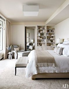 A vintage Tommi Parzinger bench from Palumbo sits at the foot of the bed in a master suite designed by Victoria Hagan; the armchair and ottoman, both by Hagan, are upholstered in a Glant Textiles fabric, and the carpeting was custom made by Tai Ping. Pin it.