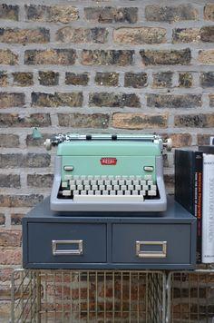 Mint green type writer.