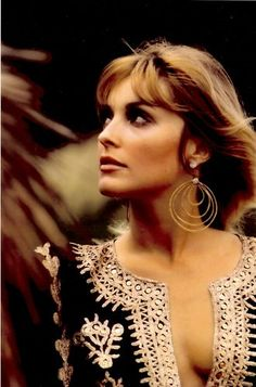 Sharon Tate, ca 1968. Those hoop earrings and Indian-kurta tunic are never out of style.