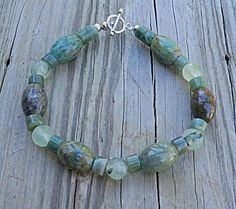 This high quality, all natural bracelet is designed from GRADE AA genuine gemstone beads of 8mm faceted moss green prehnite stone beads; and,