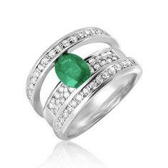 anillos piedras preciosas Anillo solitario oro blanco engastado en carriles con una esmeralda ovalada de 0,9 quilate y cubierto de diamantes...
