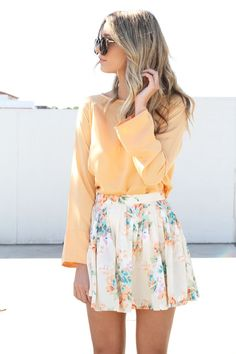 This person who is wearing a flowery skirt and a yellow shirt is very beautiful.  #spring #fashion #pastels