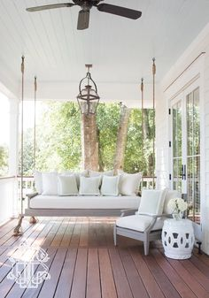 Love this hanging porch bed!