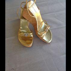 Gold bling sandals! Beautiful gold sandals with rhinestone hearts and wraparound straps perfect for the holidays or anytime! Nine West Shoes Wedges