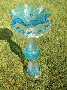 bird feeders made from old dishes | Garden art: Birdbaths made out of glass dishes