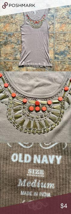 Old Navy Tank Top! Super cute Old Navy tank top! No stains or holes, in great condition! It has a cool beaded pattern on the front, as shown in the last picture. This is a great item to bundle with something else from my closet! 💕 Old Navy Tops Tank Tops