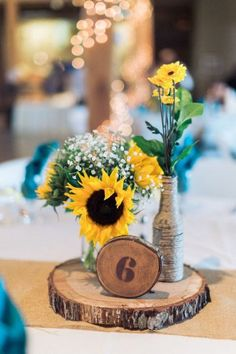 Sunflower Rustic Country Wedding Centerpiece / http://www.himisspuff.com/rustic-wedding-centerpiece-ideas/2/