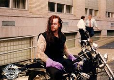 The Undertaker (old school pic). Always my FAV dead guy crush growing up.  ;-)