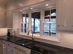 Tile backsplash with black cuntertop ideas white cabinet for Atrium white kitchen cabinets
