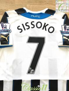Official Puma Newcastle United home football shirt from the season. Complete with Sissoko on the back of the shirt in official lettering, and Premier League patches on the sleeves Newcastle United Football, St James' Park, Aston Villa, Vintage Football, Football Jerseys, Black White Stripes, Premier League, How To Memorize Things, Patches