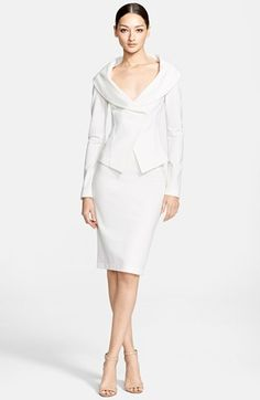 This seems a beautiful suit to me. Lovely bright winter white color.